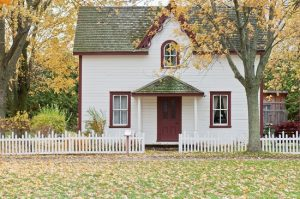 A beautiful white and red house